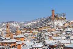 Liten stad under snön Arkivfoto