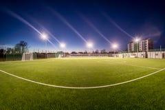 Liten stadion i natten Royaltyfria Bilder