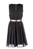 Liten svart klänning med det guld- bältet royaltyfria bilder