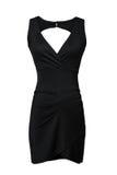 Liten svart klänning som isoleras på vit Arkivfoton