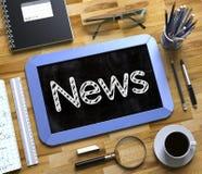Liten svart tavla med nyheternabegrepp 3d Royaltyfri Bild