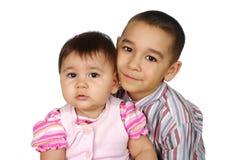 liten syster för storebror Arkivfoto