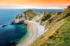 Liten vik för krig för mannolla-` på den Dorset kusten i sydliga England, mellan uddarna av den Durdle dörren till det västra och Royaltyfria Foton