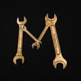 literę m Abecadło robić złoci remontowi narzędzia Obraz Royalty Free