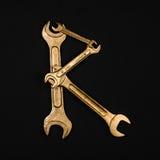 literę r Abecadło robić złoci remontowi narzędzia Zdjęcie Stock