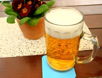 Liter of beer at the table in beer garden. Close up Stock Photo