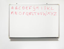 Literacy. Alphabet on real whiteboard in real classroom with rea Stock Images