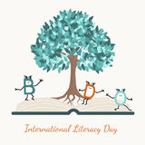 Literacy day concept tree book letter characters Stock Photography