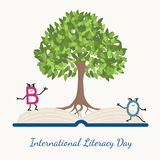 Literacy day concept tree book letter characters Royalty Free Stock Images