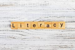 LITERACY word made with wooden blocks concept stock images