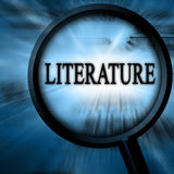 Literature. On a blue background with a magnifier Royalty Free Stock Photography