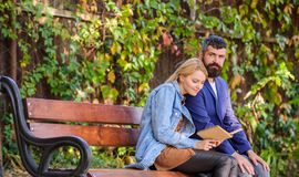 Literature common interest. How to find girlfriend with common interest. Meeting people with similar interests. Man and. Women sit bench park. Read same book royalty free stock image