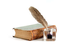 Literature Concept. Stylish vintage inkwell near old book on white background Stock Images