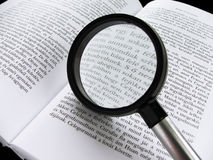 Literature I. The magnifying glass is on the book Stock Image