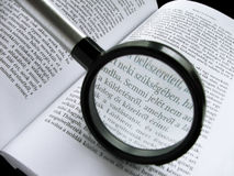 Literature II. The magnifying glass is on the book Stock Image