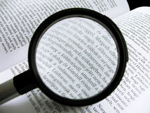 Literature III. The magnifying glass is on the book Royalty Free Stock Photo