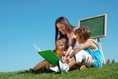 Literature lesson outdoor. Literature lesson on fresh air Royalty Free Stock Photos