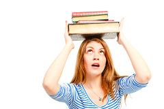 Literature lies on  head of  beautiful student Royalty Free Stock Image