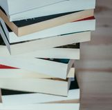 Literature for study: Stack of books on wooden board. Stack of different books on wooden table: Literature for study sale searching reading document knowledge royalty free stock photo