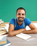 Literature teacher. Photo adult man with books in classroom Stock Photos