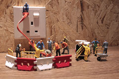 Litet arbetararbete på den elektriska proppen Royaltyfri Fotografi