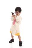 Litet asiatiskt barn som låtsar för att vara affärsman Fotografering för Bildbyråer