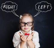 Litet barn och högra och vänstersidahänder rolig flicka arkivbilder