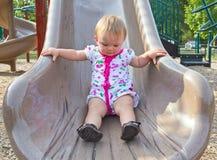 Litet barn på glidbana Royaltyfria Foton