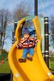 Litet barn på glidbana Fotografering för Bildbyråer