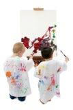 litet barn två för pojkestafflimålning royaltyfria bilder