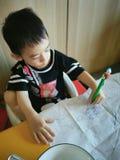 Litet barnhandstil royaltyfri bild