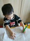 Litet barnhandstil royaltyfria foton