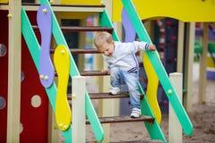 Litet barnpojke på lekplats Royaltyfria Bilder