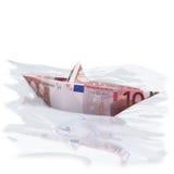 Litet pappers- fartyg med 10 euro Royaltyfria Bilder