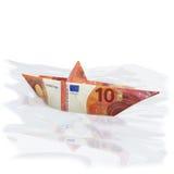 Litet pappers- fartyg med nya 10 euro Royaltyfria Bilder
