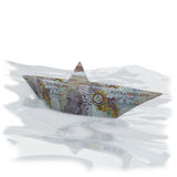 Litet pappers- fartyg med 10 pund ett pund sterling Arkivfoto