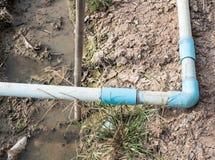 Litet PVC-rör med armbågen Royaltyfri Foto