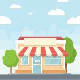 Litet shoppa det stads- landskapet i plan designstil, vektorillustration Inkluderar affären, byggnader, träd, gata Fotografering för Bildbyråer