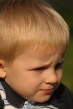 litet solsken för pojkeframsida s royaltyfria bilder