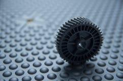 Litet svart plast- mekaniskt hjul som används under royaltyfri bild