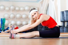 Lithe body. Young sporty woman in the gym centre Stock Photography