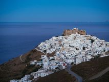 A lithe road leading to Chora of Astypalaia in blue hour.  Stock Photo