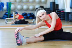 Lithe woman. Young sporty woman in the gym centre Royalty Free Stock Photography