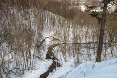 Lithianian small river Duksta. In winter time, view from Buivydu piliakalnis stock photo