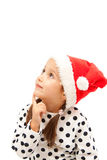 Lithle girl dreaming aboout christmas Royalty Free Stock Images