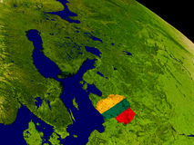 Lithuania with flag on Earth Stock Image