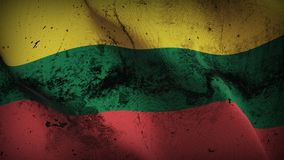 Lithuania grunge dirty flag waving on wind. Lithuanian background fullscreen grease flag blowing on wind. Realistic filth fabric texture on windy day Stock Photo