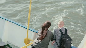 LITHUANIA, KLAIPEDA 30 August 2014. A man and a woman are standing on the board of the ship their back to the camera. LITHUANIA, KLAIPEDA 30 August 2014. A stock footage
