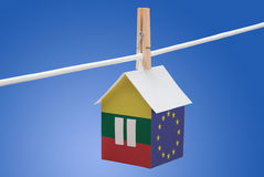 Lithuania, Lithuanian and EU flag on paper house. Concept - Lithuania, Lithuanian and Euoropean flag painted on a paper house hanging on a rope Stock Photo