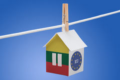 Lithuania, Lithuanian and EU flag on paper house. Concept - Lithuania, Lithuanian and Euoropean flag painted on a paper house hanging on a rope Royalty Free Stock Images